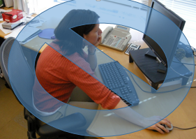 image of woman slouching at desk
