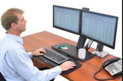 Image of man with two correctly positioned monitors