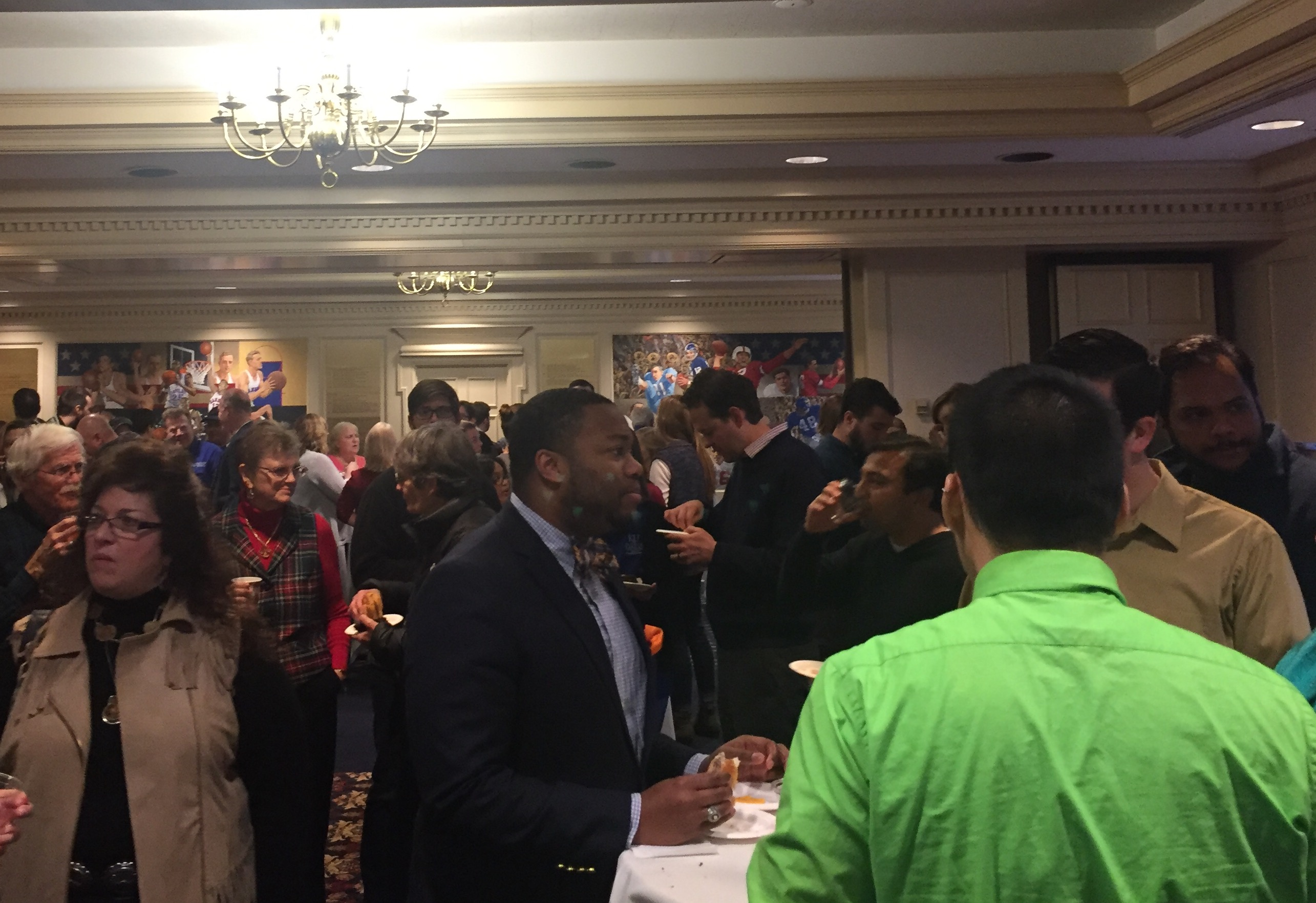 Staff and Faculty members mingle at the reception